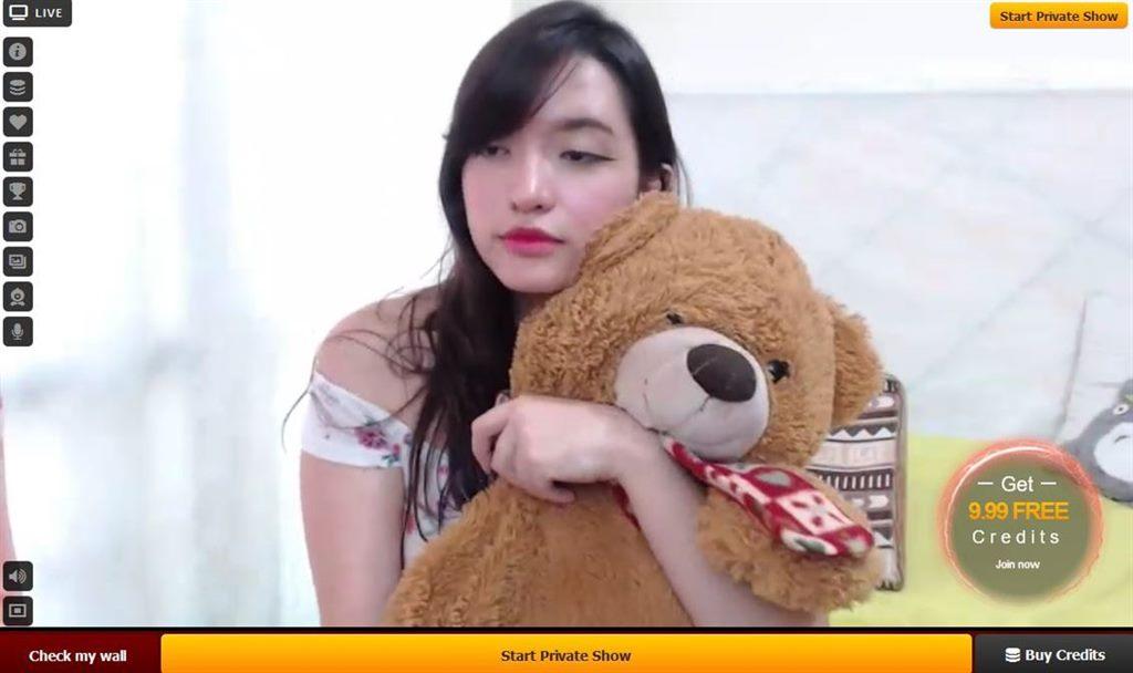 Cute oriental cam girl with her teddy bear on LiveJasmin.com