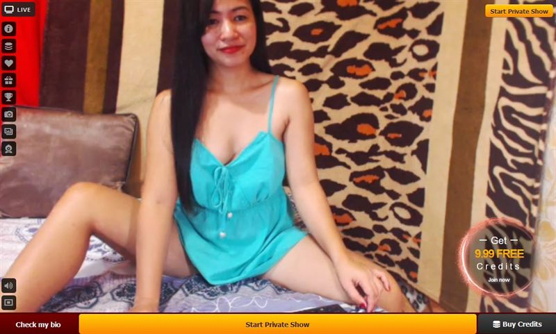 A sexy oriental cam babe relaxes between shows on LiveJasmin.com