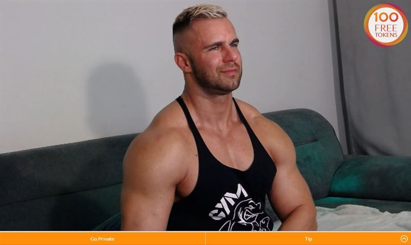 Toned muscled gay guy in tank top on Cams.com