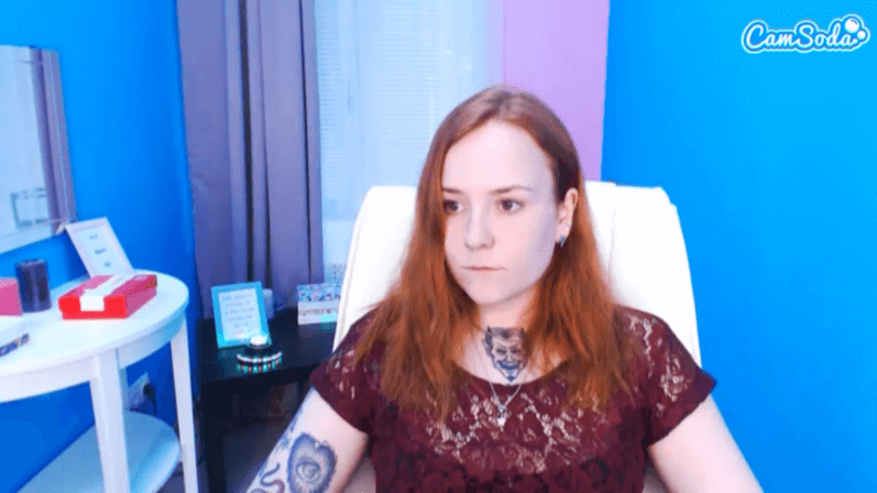 Cute ginger with devil neck tattoo on CamSoda