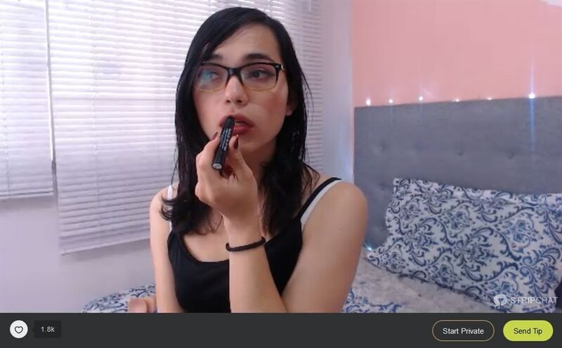 Cute latina tgirl on Stripchat putting on lipstick